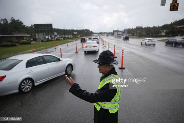 Jack Ross from the South Carolina Highway Patrol directs traffic onto US 501 as the South Carolina government ordered that traffic use all the lanes...