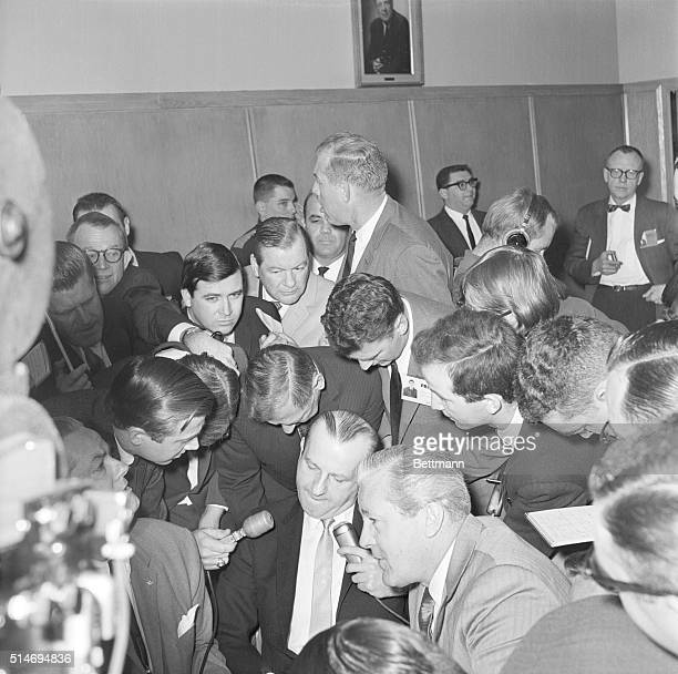 Jack Ruby and Melvin Belli answer reporters questions outside a Dallas courtroom. Ruby is there for a change of venue hearing on his charge of...