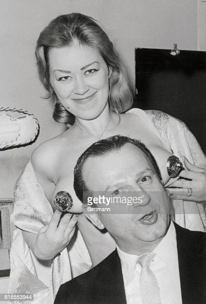 Jack Ruby shown at his club in this 1962 file photo is seen with an unidentified member of his burlesque act