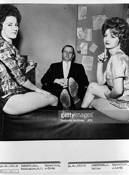 Jack Ruby sits with two of his dancers at his nightclub the Carousel Club This photograph was part of the evidence in the John F Kennedy...