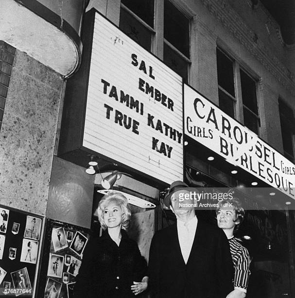 Jack Ruby stands with two of his dancers outside his nightclub the Carousel Club This photograph was part of the evidence in the John F Kennedy...