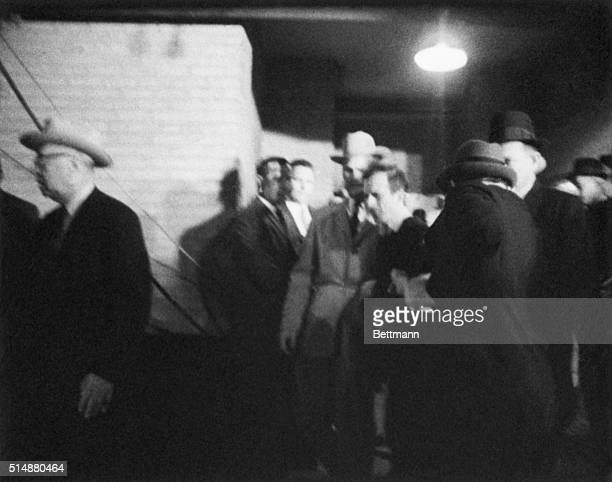 Jack Ruby walks up to accused presidential assassin Lee Harvey Oswald and shoots him as he is escorted into a police station in Dallas