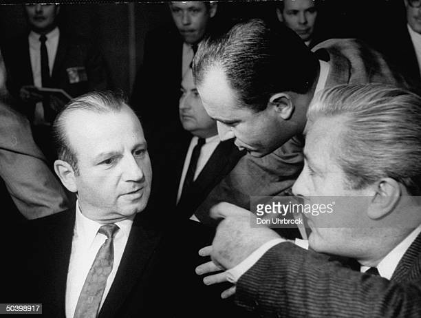 Jack Ruby with defense attorneys Melvin M Belli and Sam Brody at pretrial hearing