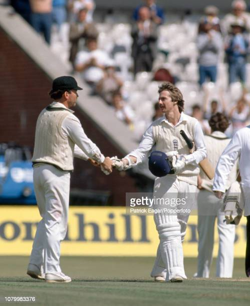Jack Russell of England is congratulated on reaching his century by Australia's captain Allan Border during the 4th Test match between England and...