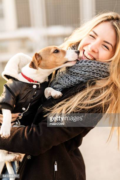 Jack Russell puppy and his owner enjoying