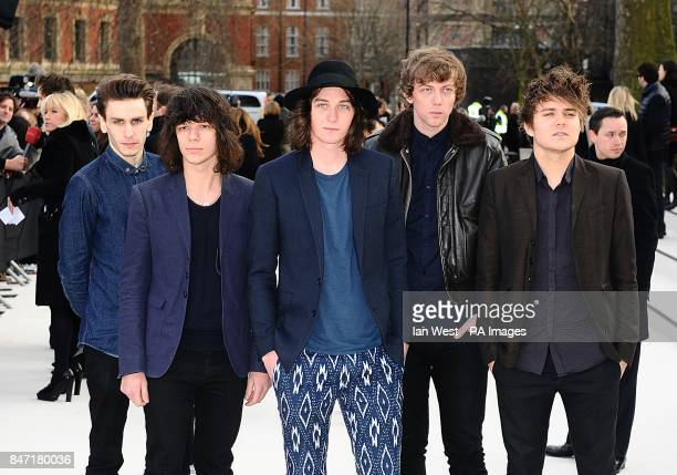 Jack Sails George Craig Daniel Parkin James Craig and Mark Haytom of One Night Only arriving for the Burberry Prorsum show at Kensington Gore London