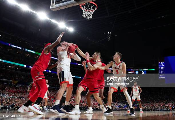 Jack Salt of the Virginia Cavaliers controls ball against the Texas Tech Red Raiders in the first half during the 2019 NCAA men's Final Four National...