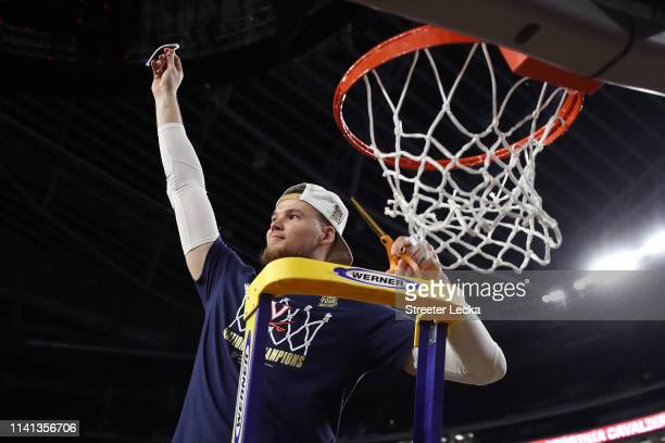 Jack Salt of the Virginia Cavaliers cuts down the net after his teams 8577 win over the Texas Tech Red Raiders in the 2019 NCAA men's Final Four...