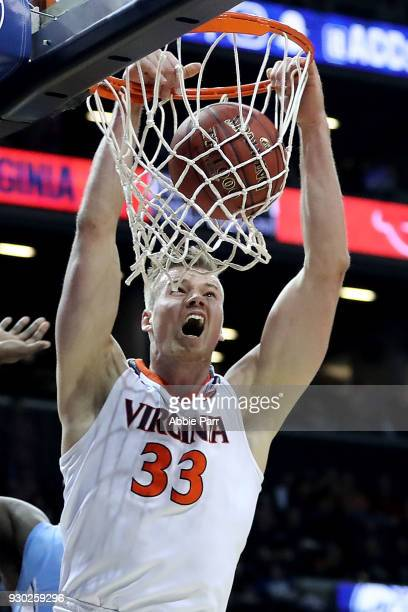 Jack Salt of the Virginia Cavaliers dunks the ball in the second half against the North Carolina Tar Heels during the championship game of the 2018...