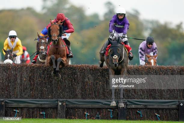 Jack Savage riding Locker Room Talk clear the last to win The Bet At racingtv.com Handicap Chase at Kempton Park Racecourse on October 18, 2020 in...