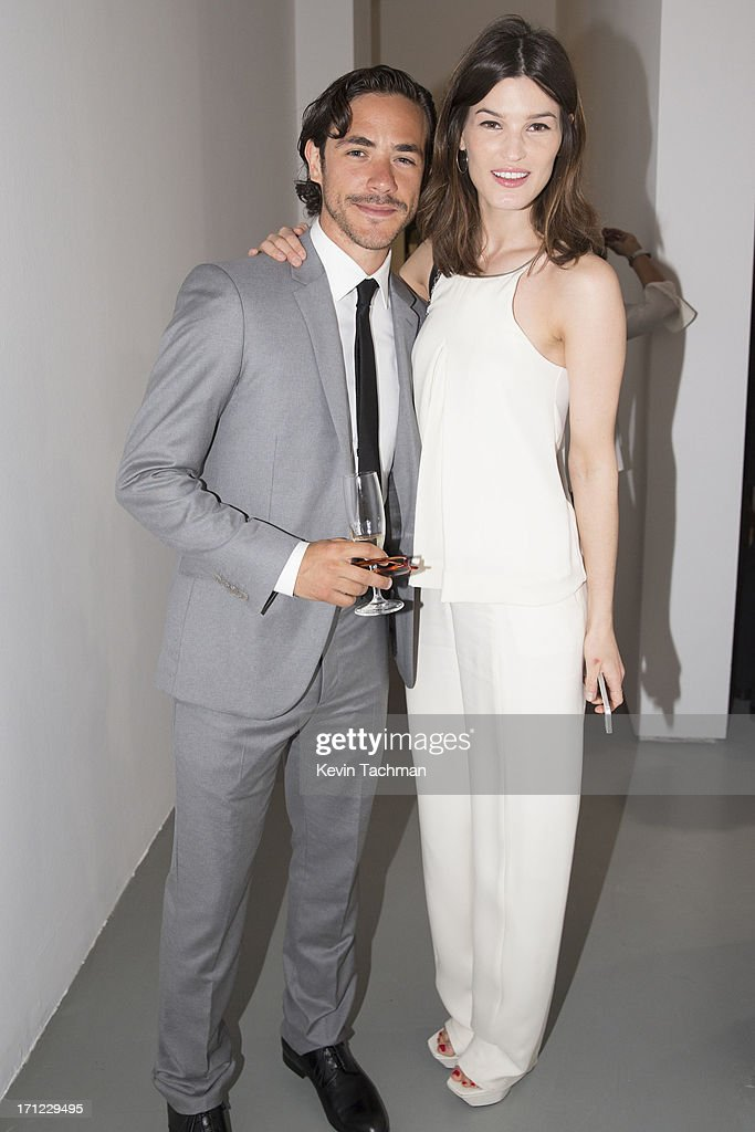Jack Savoretti, left, and Hanneli Mustaparta attend the Calvin Klein Collection show during Milan Menswear Fashion Week Spring Summer 2014 on June 23, 2013 in Milan, Italy.