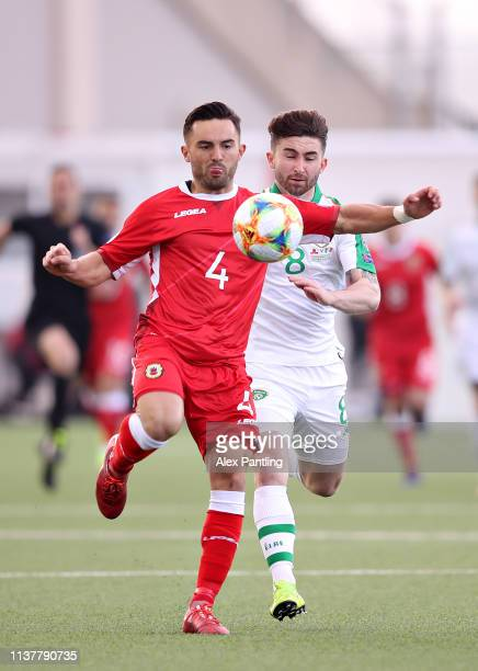 Jack Sergeant of Gibraltar is challenged by Sean Maguire of Republic of Ireland during the 2020 UEFA European Championships group D qualifying match...