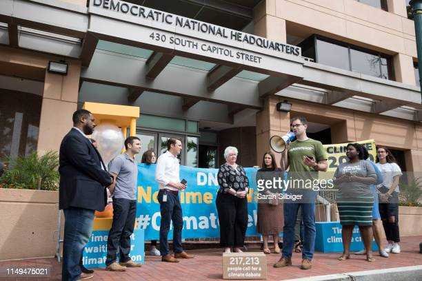 Jack Shapiro speaks in front of the Democratic National Committee headquarters during a Greenpeace rally to call for a presidential campaign climate...