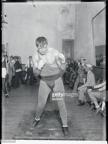 Jack Sharkey, the Boston heavyweight, is hard to work getting into condition for his coming bout with Harry Wills, the colored heavyweight of New...