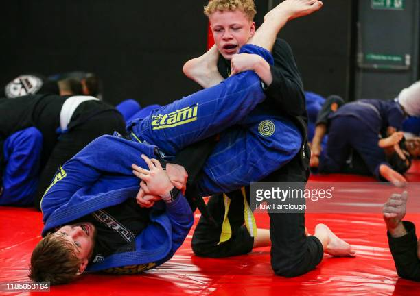 Jack Shore grapples with a young student at the opening of Shore Mixed Martial Arts on November 2 2019 in Abertillery Wales