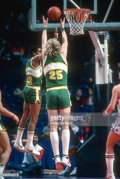 Jack Sikma of the Seattle Supersonics goes up to grab a rebound against the Washington Bullets during an NBA basketball game circa 1982 at the...