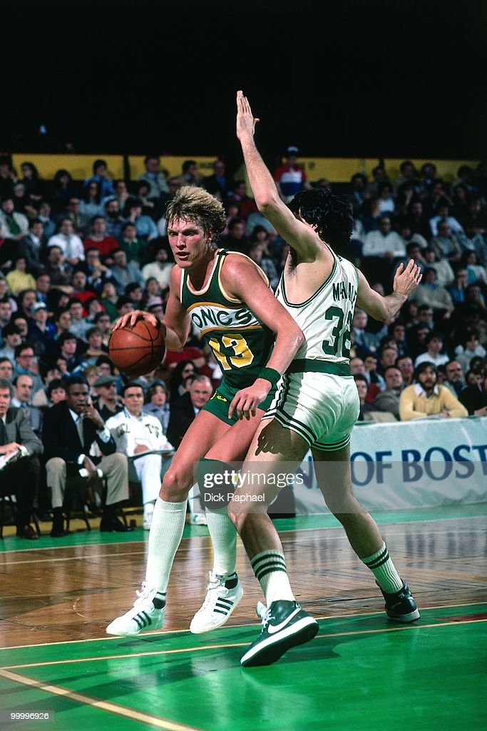 Jack Sikma #43 of the Seattle Supersonics makes a move to the basket against Kevin McHale #32 of the Boston Celtics during a game played in 1983 at the Boston Garden in Boston, Massachusetts.