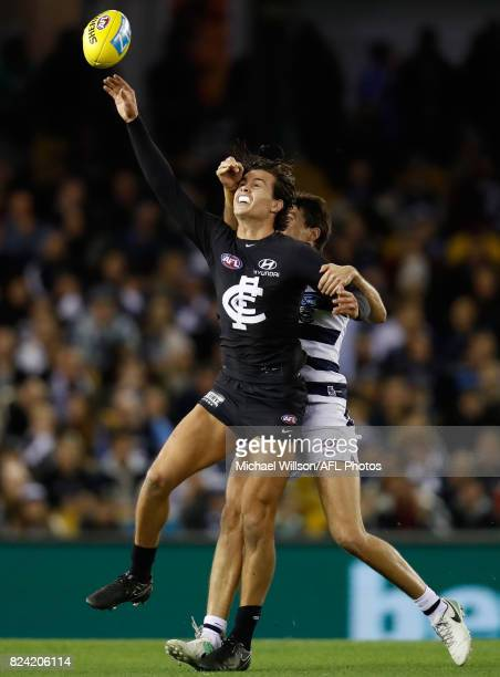 Jack Silvagni of the Blues and Andrew Mackie of the Cats compete for the ball during the 2017 AFL round 19 match between the Carlton Blues and the...