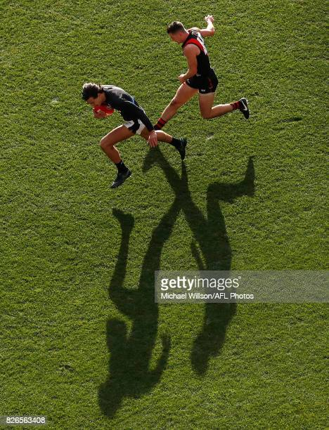 Jack Silvagni of the Blues and Conor McKenna of the Bombers compete for the ball during the 2017 AFL round 20 match between the Essendon Bombers and...