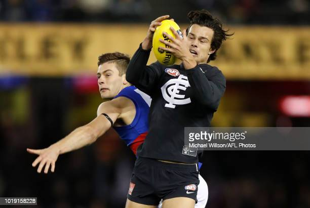 Jack Silvagni of the Blues and Josh Dunkley of the Bulldogs compete for the ball during the 2018 AFL round 22 match between the Carlton Blues and the...