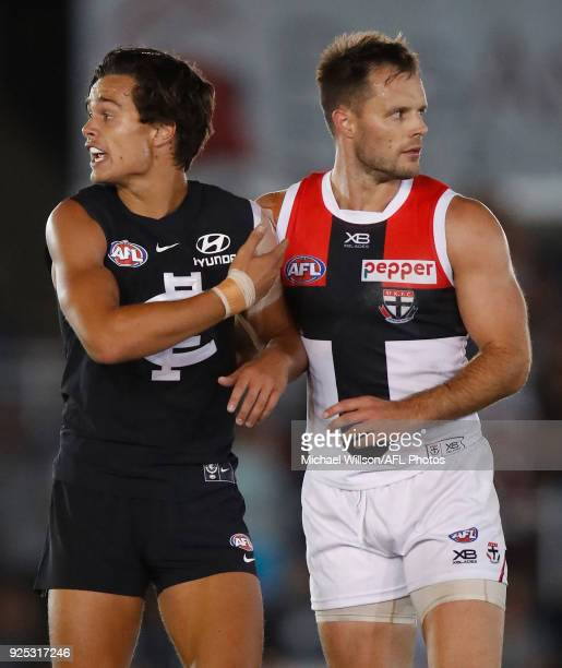 Jack Silvagni of the Blues and Nathan Brown of the Saints lookson during the AFL 2018 JLT Community Series match between the Carlton Blues and the St...