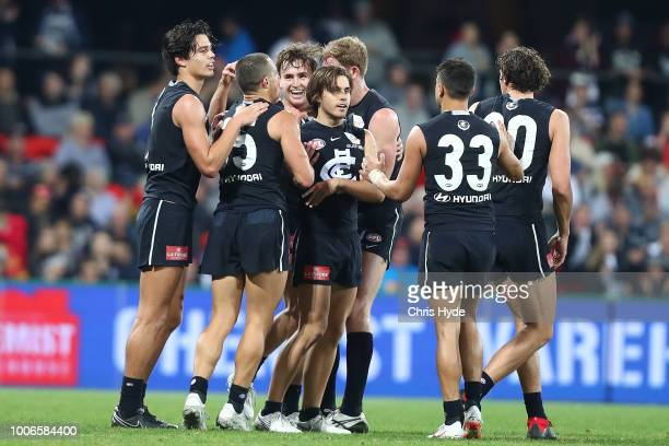 Jack Silvagni of the Blues celebrates a goal during the round 19 AFL match between the Gold Coast Suns and the Carlton Blues at Metricon Stadium on...