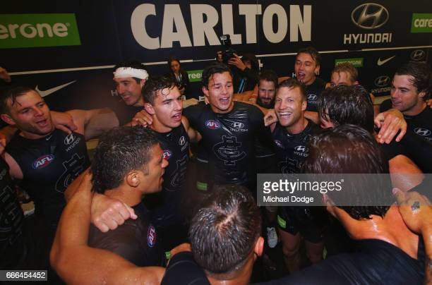Jack Silvagni of the Blues celebrates his first ever win with Sam PetrevskiSeton Tom Williamson and Rhys Palmer during the round three AFL match...