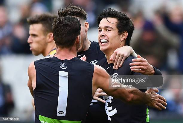 Jack Silvagni of the Blues is congratulated by team mates after kicking a goal during the round 16 AFL match between the Carlton Blues and the...