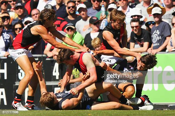 Jack Silvagni of the Blues is dragged away by Martin Gleeson during a melee in the 2016 AFL NAB Challenge match between Carlton and Essendon at Ikon...