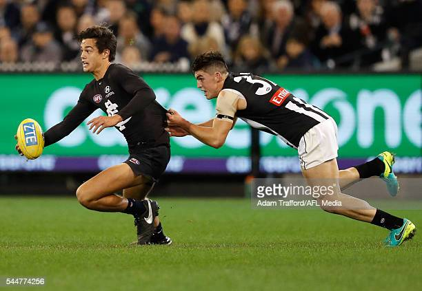 Jack Silvagni of the Blues is tackled by Brayden Maynard of the Magpies during the 2016 AFL Round 15 match between the Carlton Blues and the...