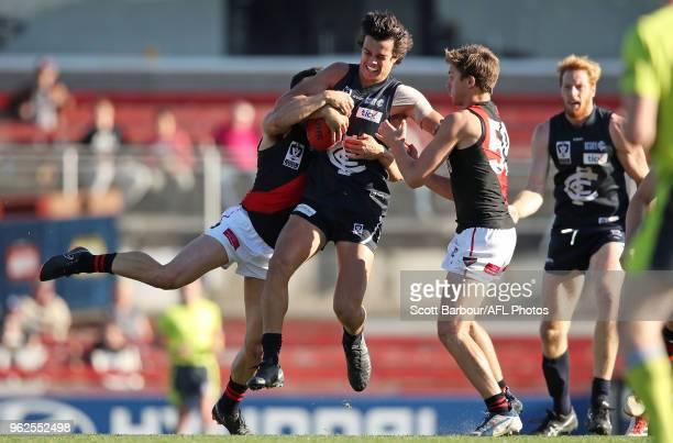 Jack Silvagni of the Blues is tackled during the round eight VFL match between the Northern Blues and Essendon at Ikon Park on May 26 2018 in...