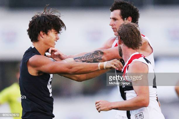 Jack Silvagni of the Blues wrestles with Jake Carlisle and Jimmy Webster of the Saints in a melee after Jack Sinclair of the Saints was hit late by...