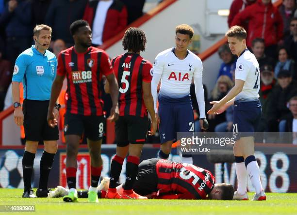 Jack Simpson of AFC Bournemouth goes to ground after being fouled by Juan Foyth of Tottenham Hotspur, a foul referee Craig Pawson awards Juan Foyth...