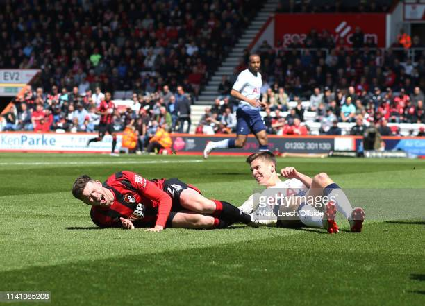 Jack Simpson of Bournemouth is fouled by Juan Foyth of Tottenham who received a red card for the bad tackle during the Premier League match between...