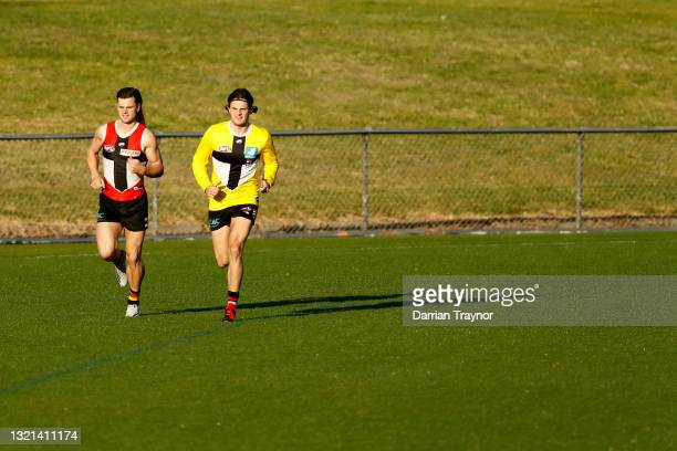 Jack Sinclair and Hunter Clark of the Saints warm up during a St Kilda Saints AFL training session at RSEA Park on June 03, 2021 in Melbourne,...