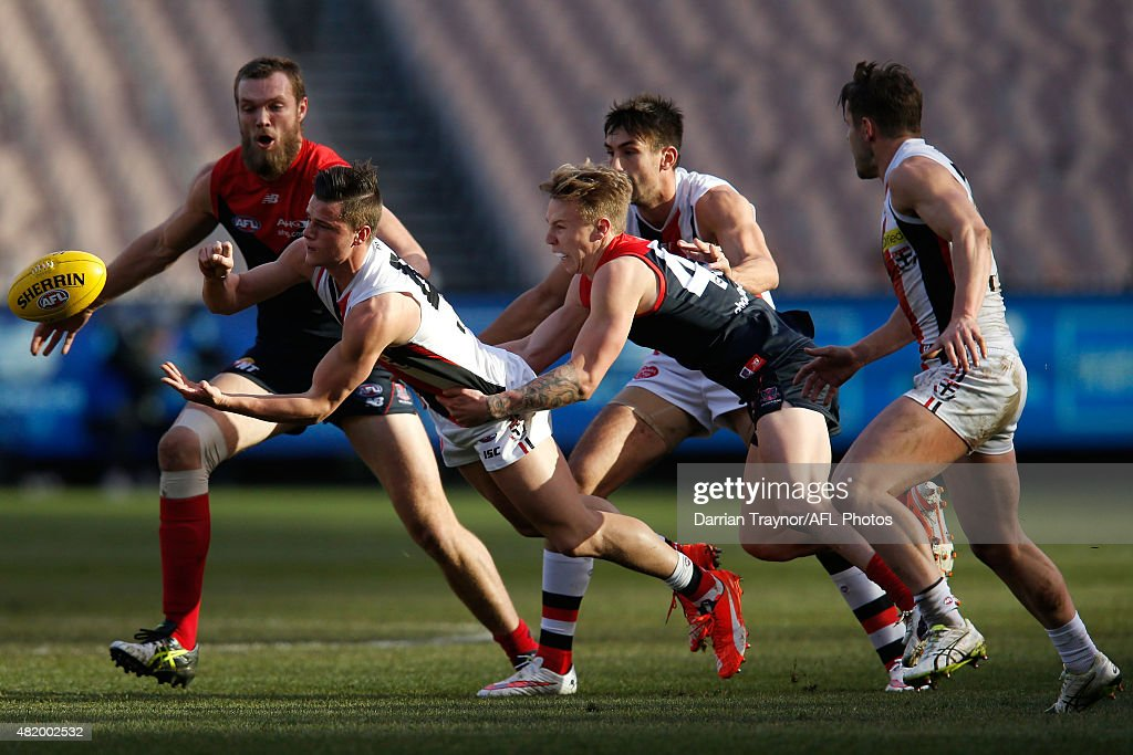 Jack Sinclair of the Saints handballs during the round 17 AFL match between the Melbourne Demons and the St Kilda Saints at Melbourne Cricket Ground on July 26, 2015 in Melbourne, Australia.