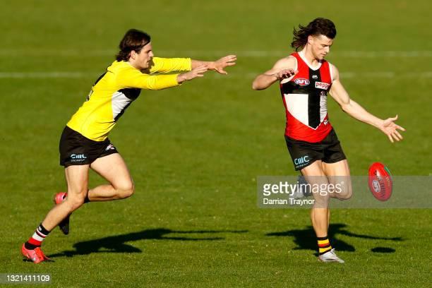 Jack Sinclair of the Saints kicks the ball during a St Kilda Saints AFL training session at RSEA Park on June 03, 2021 in Melbourne, Australia.