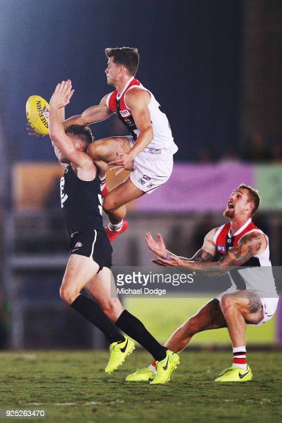 Jack Sinclair of the Saints takes a high mark over Ciaran Byrne of the Blues during the JLT Community Series AFL match between the Carlton Blues and...
