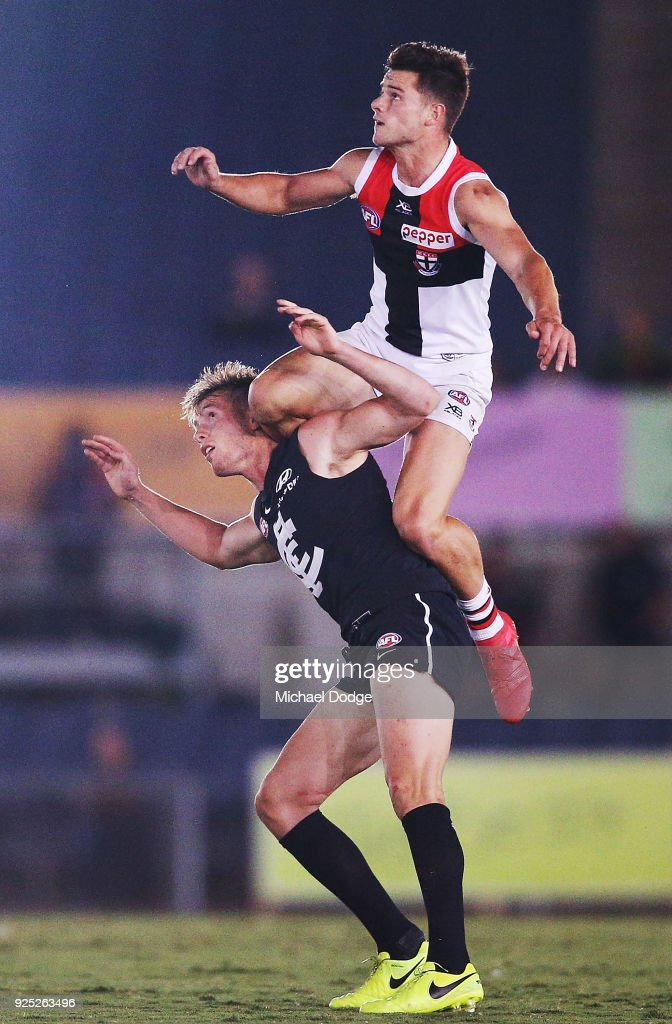 Jack Sinclair of the Saints takes a high mark over Ciaran Byrne of the Blues during the JLT Community Series AFL match between the Carlton Blues and the St Kilda Saints at Ikon Park on February 28, 2018 in Melbourne, Australia.