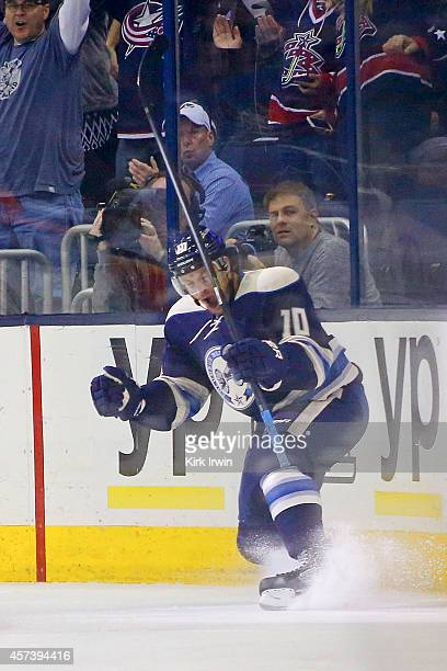 Jack Skille of the Columbus Blue Jackets celebrates after scoring a goal during the first period against the Calgary Flames on October 17 2014 at...