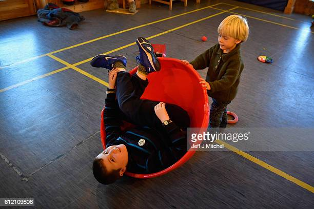 Jack Smith and Alfie Grear play during the primary school coffee morning on the Island of Foula September 30 2016 in Foula Scotland Foula is the...
