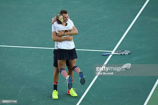 Jack Sock and Bethanie Mattek-Sands of the United States celebrate victory in the mixed doubles gold medal match against Rajeev Ram and Venus...