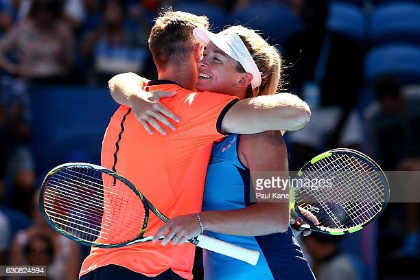 Jack Sock and Coco Vandeweghe of the United States embrace after winning the mixed doubles match against Lara Arruabarrena and Feliciano Lopez of...
