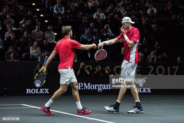 Jack Sock and John Isner of the Team World in action against Czech Republic's Tomas Berdych and Croatian Marin Cilic of the Team Europe during the...