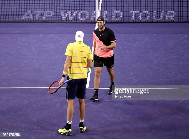 Jack Sock and John Isner of the United States celebrate after winning a point in their match against Ivan Dodig of Croatia Rajeev Ram of the United...