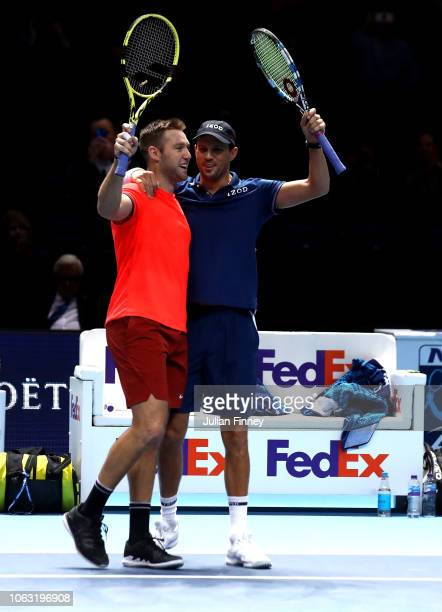 Jack Sock and Mike Bryan of The United States celebrate victory following thier doubles final against Pierre-Hugues Herbert and Nicolas Mahut of...