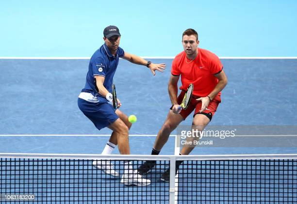 Jack Sock and Mike Bryan of The United States return the ball during thier doubles final against Pierre-Hugues Herbert and Nicolas Mahut of France...
