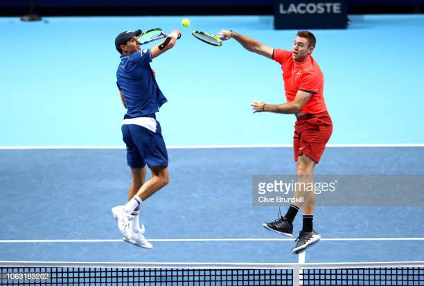 Jack Sock and Mike Bryan of The United States return the ball during thier doubles final against PierreHugues Herbert and Nicolas Mahut of France...