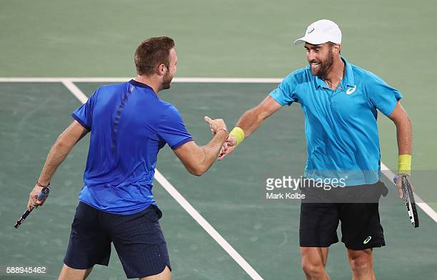 Jack Sock and Steve Johnson of the United States celebrate match point in the Men's Doubles Bronze medal match against Vasek Pospisil and Daniel...