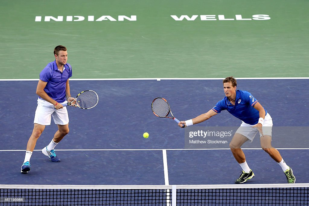 Jack Sock and Vasek Pospisil of Canada play Simone Bolelli and Fabio Fognini of Italy during the doubles final on day thirteen of the BNP Paribas Open at the Indian Wells Tennis Garden on March 21, 2015 in Indian Wells, California.